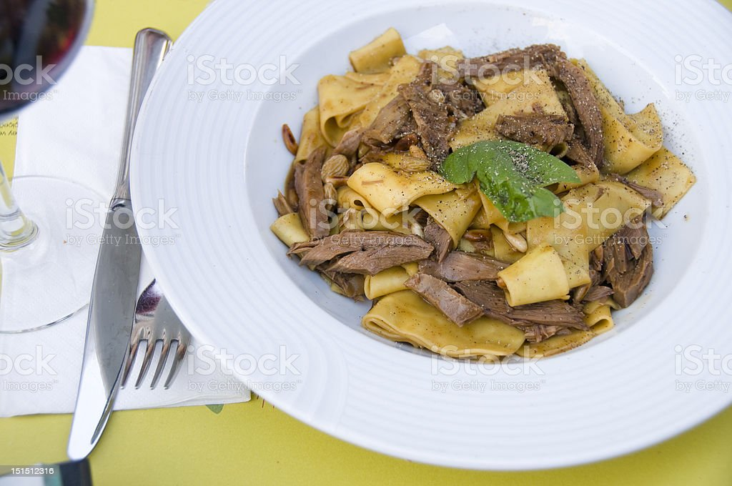 Papparadelle pasta with duck meat stock photo