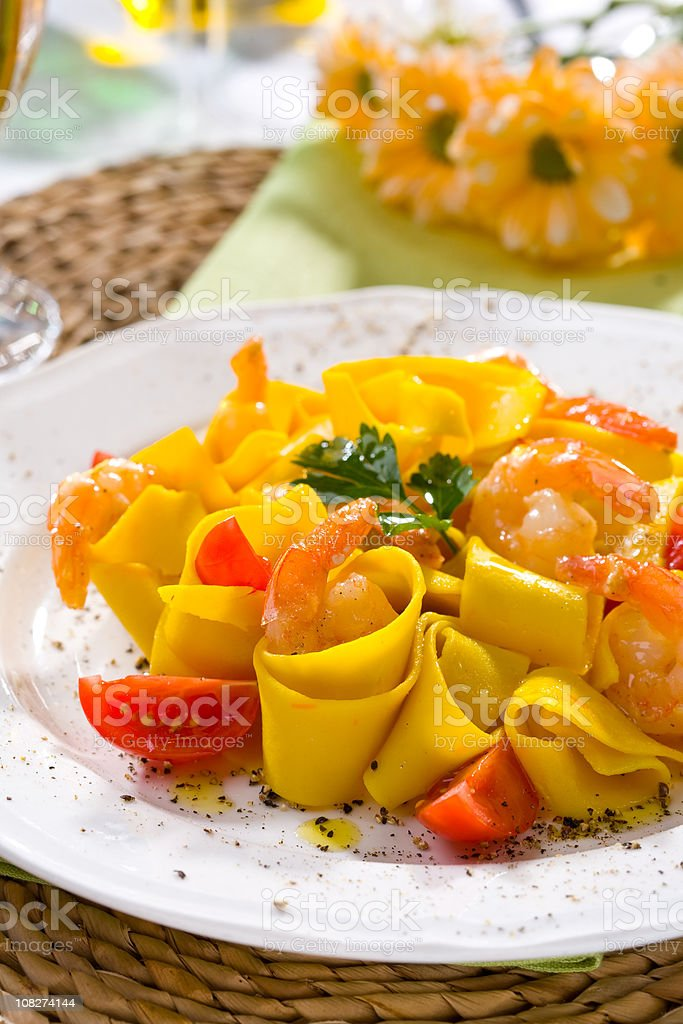 Papparddelle with fried prawn stock photo