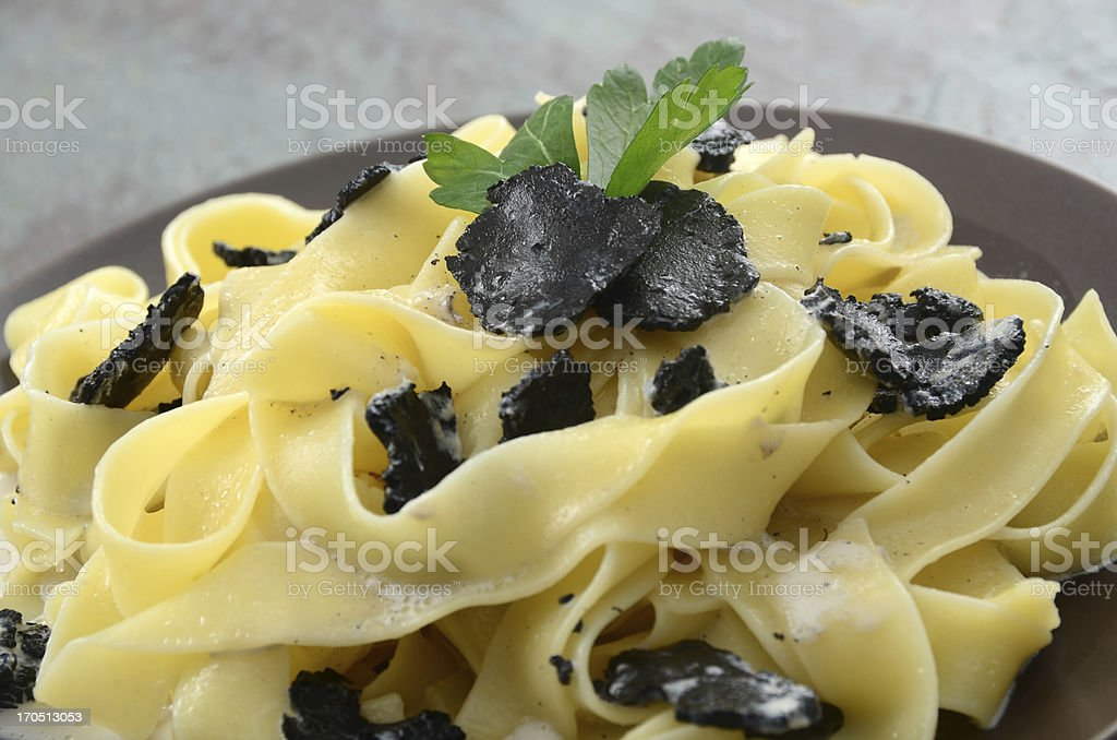 Pappardelle pasta with black truffles stock photo
