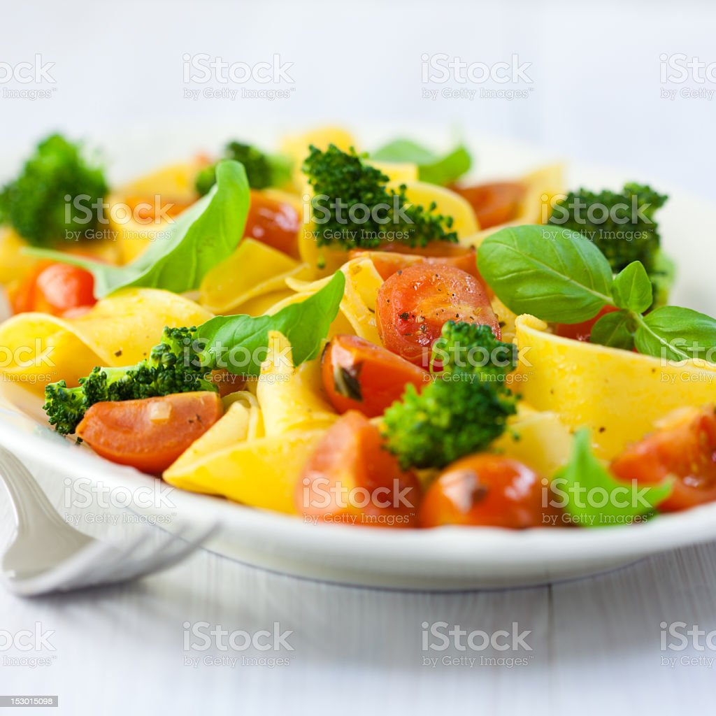 Pappardelle pasta with cherry tomato and broccoli stock photo