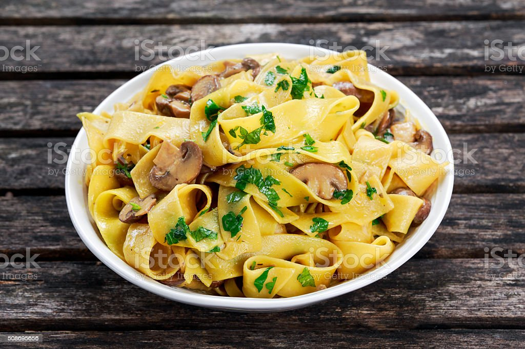 Pappardelle Pasta with mushrooms and other herbs stock photo