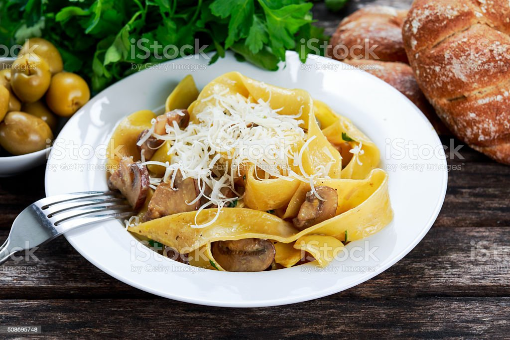 Pappardelle Pasta with mushrooms, cheese and other herbs stock photo