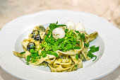 pappardelle pasta with pesto.