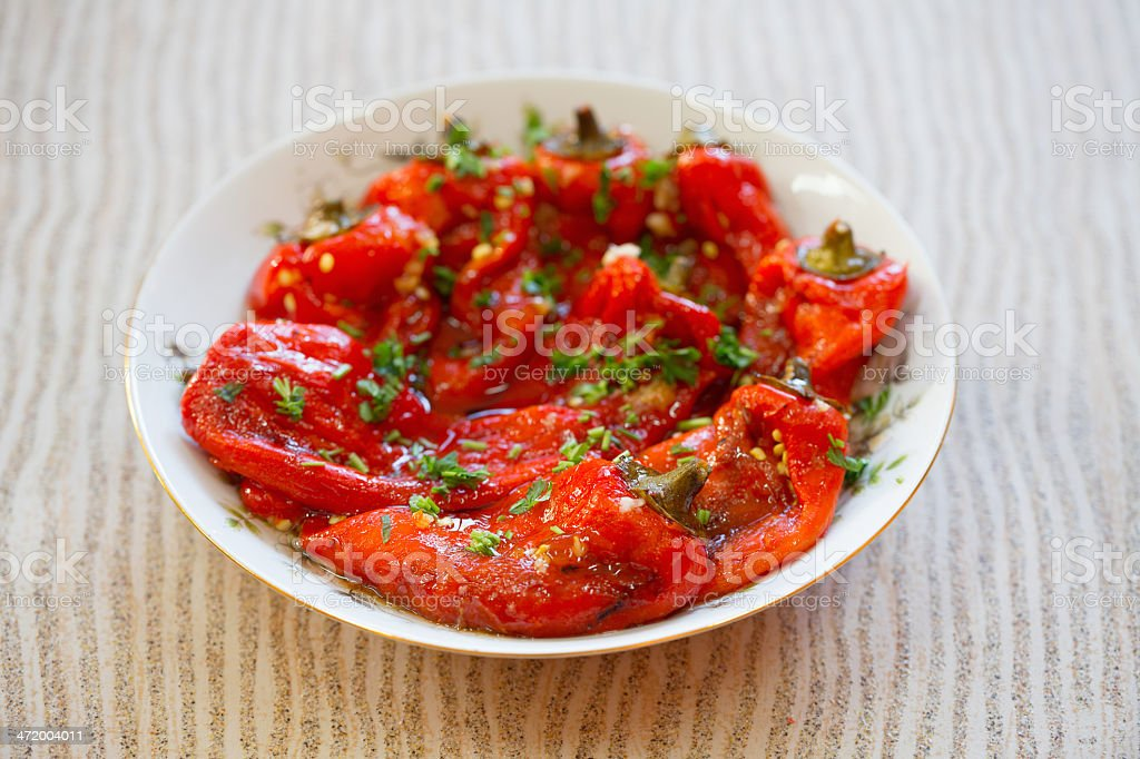 Paprika roasted bell peppers in a bowl on a table stock photo