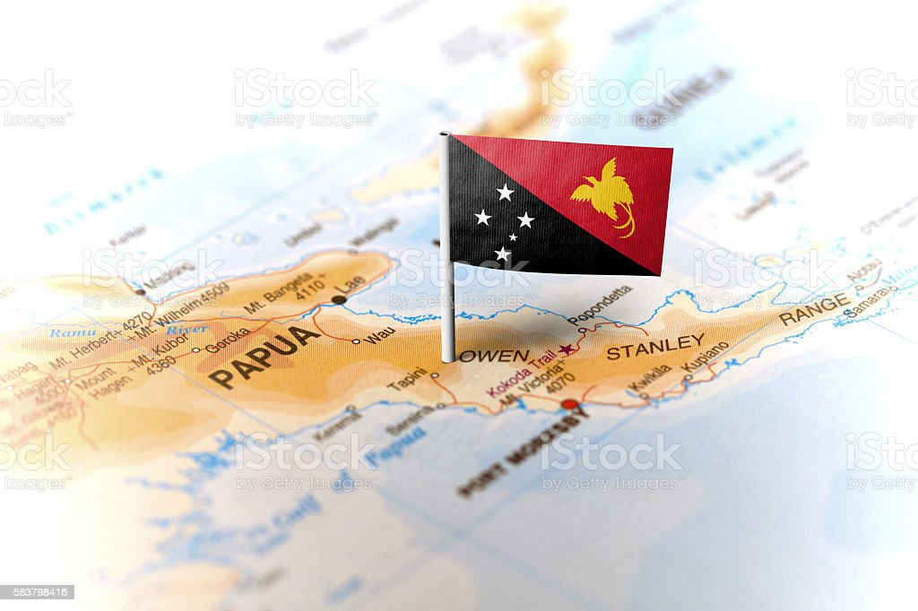 Papua New Guinea pinned on the map with flag stock photo