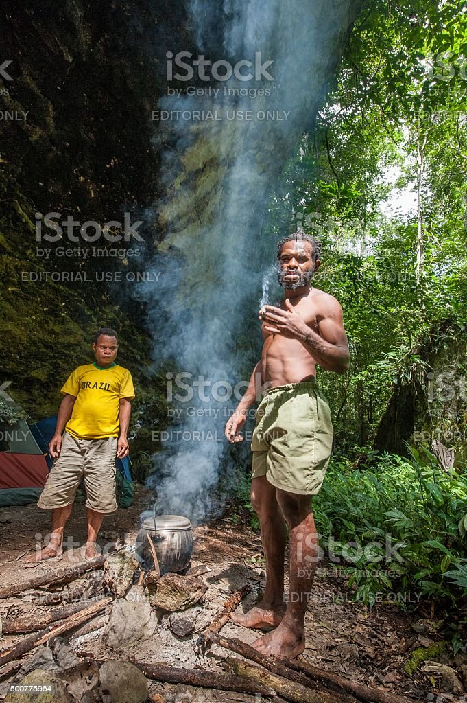 Papuans of the island New Guinea have dinnerood. stock photo