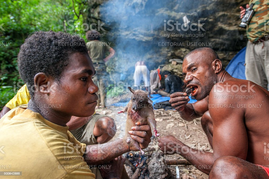 Papuans of the island New Guinea have dinnert fly fox. stock photo
