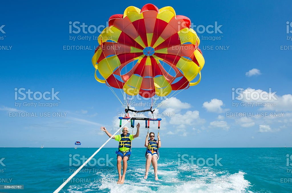 Para sailing near coast stock photo