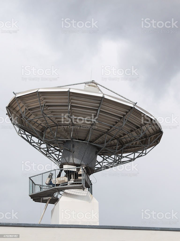 Parabolic satellite radar antenna dish for radio television tra stock photo