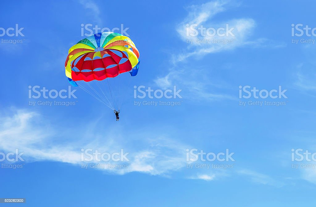 Parachute jumping. Parachute is in the sky, under the clouds. stock photo