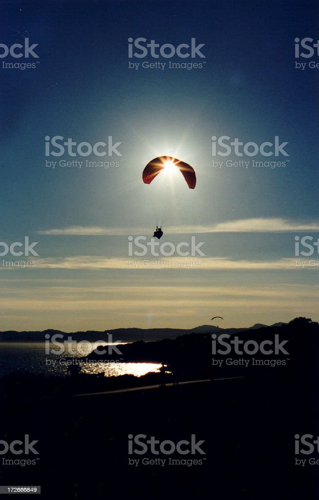 Parachuter caught in the sunset royalty-free stock photo