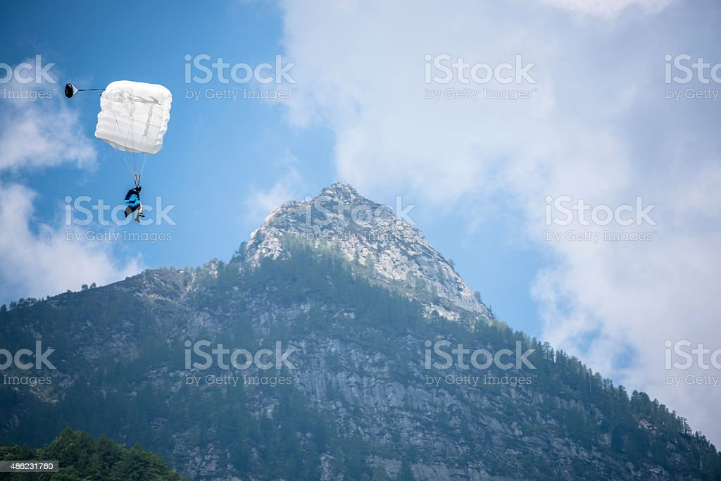 Parachuter comes in for touch down in Bern Canton, Switzerland. stock photo