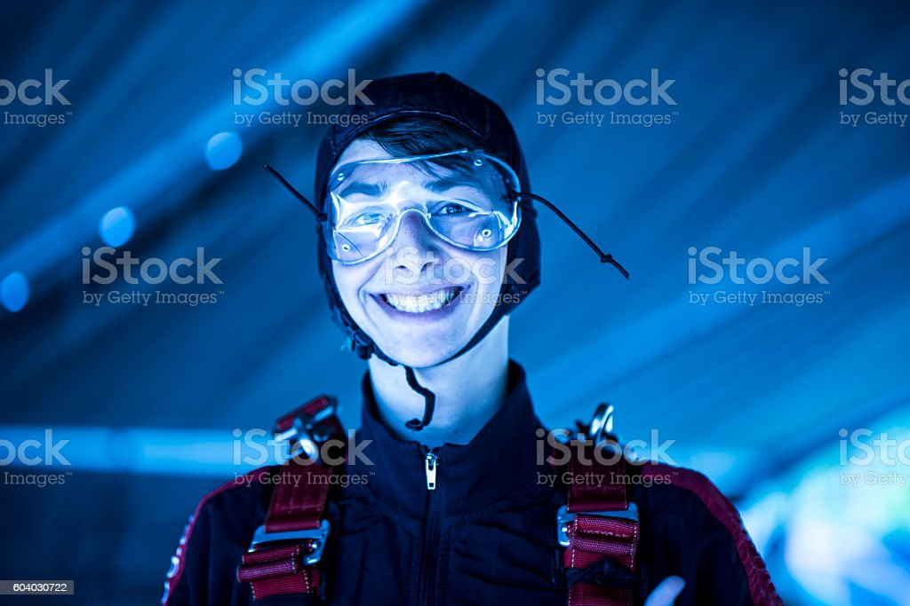 Parachuter smiling before his jump stock photo
