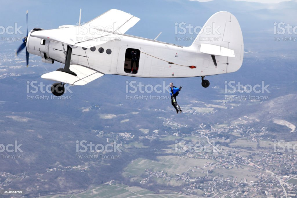 Parachuters jump from a plane stock photo