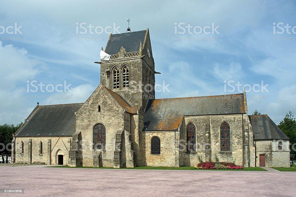 Parachutist hangs on the church in Sainte Mere Eglise stock photo