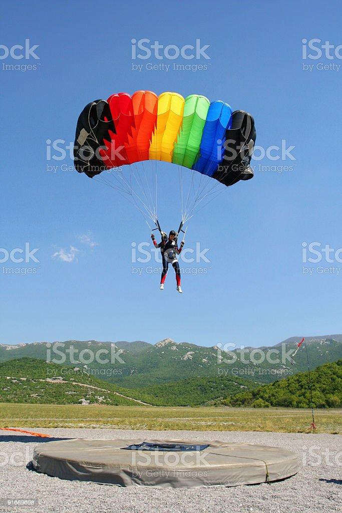 Parachutist landing stock photo