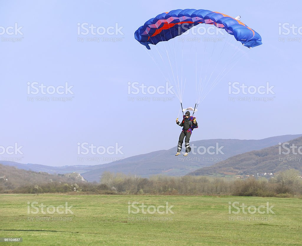 Parachutist landing royalty-free stock photo
