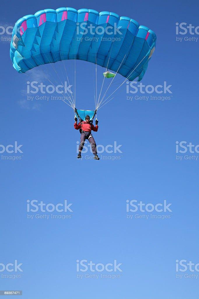 Parachutist on the blue sky stock photo