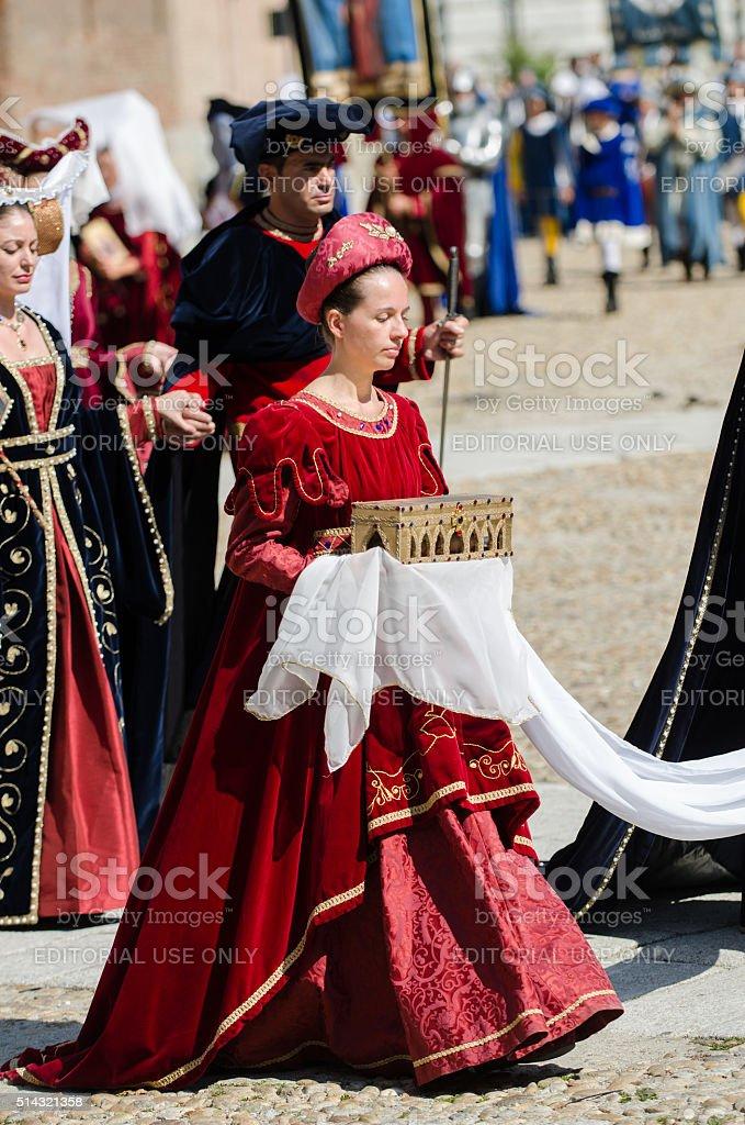 Parade of bridesmaid with casket of precious stock photo