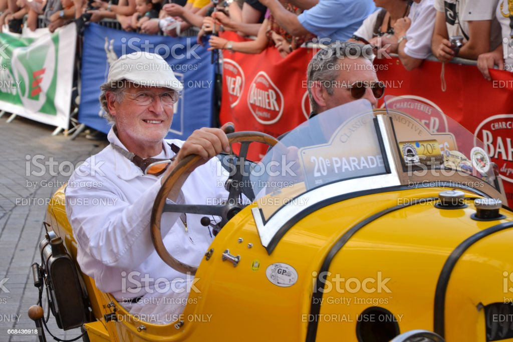 LE MANS, FRANCE - JUNE 13, 2014:Parade of pilots racing.Presentation of Morgan Darmont car. stock photo