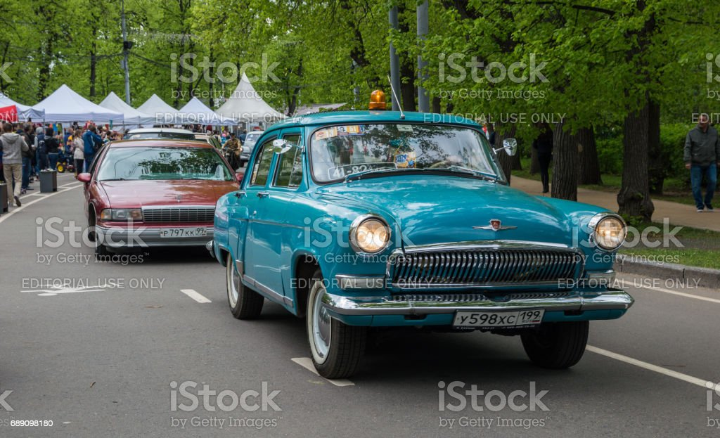 Parade of the soviet and american classic cars stock photo