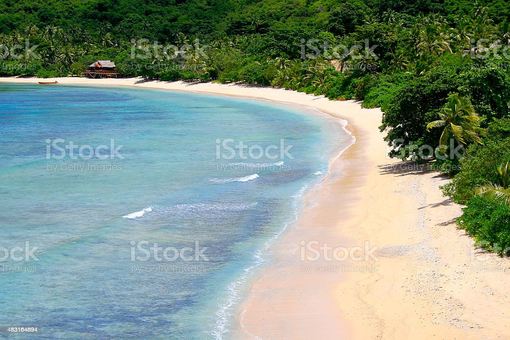 Paradise: aerial Fiji Yasawa islands, deserted turquoise beach and bungalow stock photo