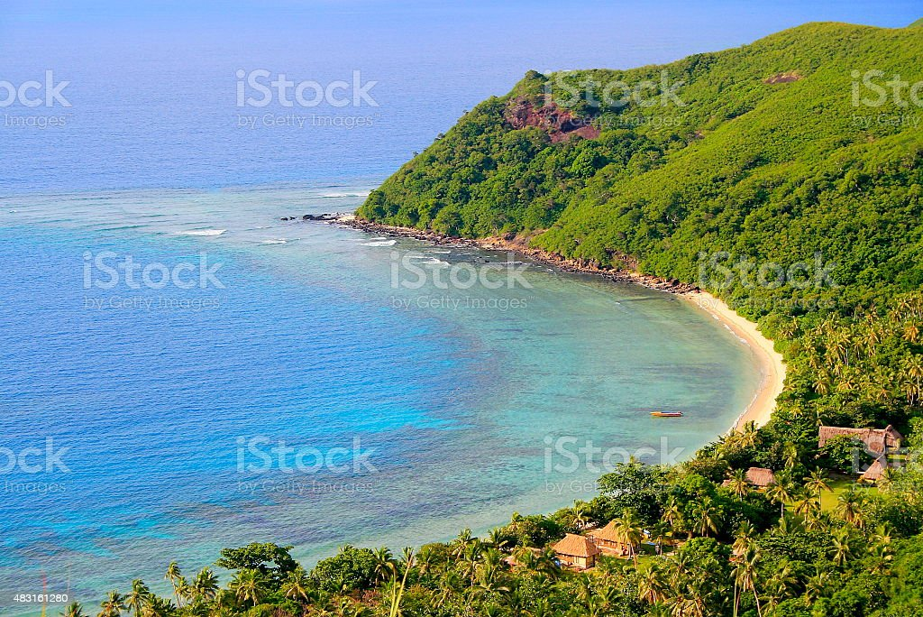 Paradise: aerial Fiji Yasawa islands, turquoise beach and bungalow palapas stock photo
