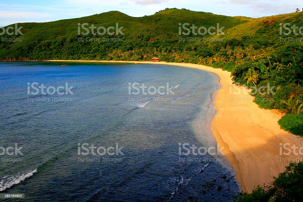 Paradise: aerial Fiji Yasawa islands view, turquoise beach and bungalow stock photo