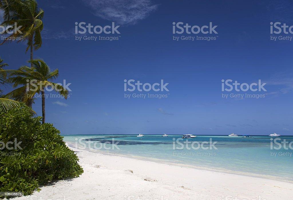 Paradise beach with boats royalty-free stock photo