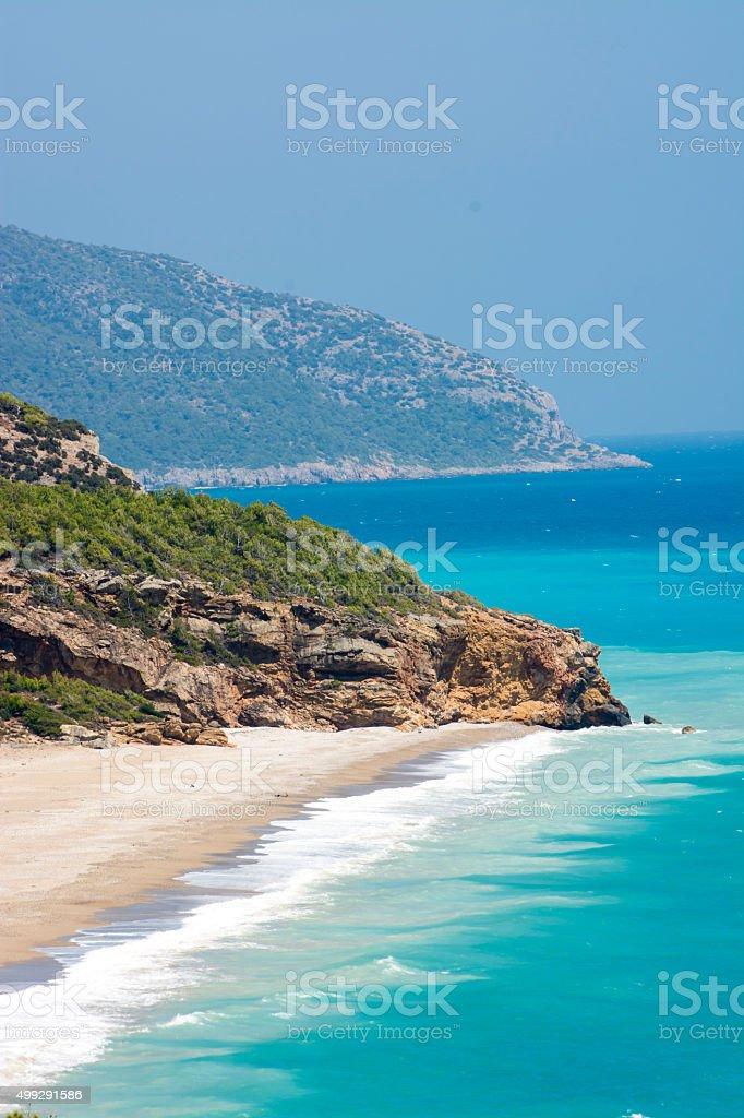 Paradise Beach with mountains stock photo