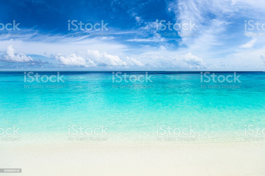 paradise beach with turquoise blue water stock photo