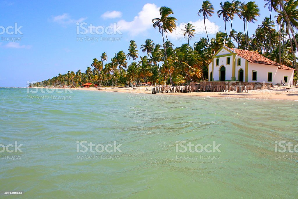 Paradise: deserted Palm Beach and Church in Pernambuco, Northeastern Brazil stock photo