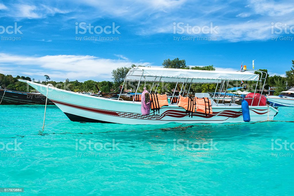 Paradise Island with a Long tail boat stock photo