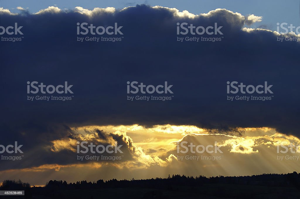 Paradise: Rays of light shining through dark clouds royalty-free stock photo