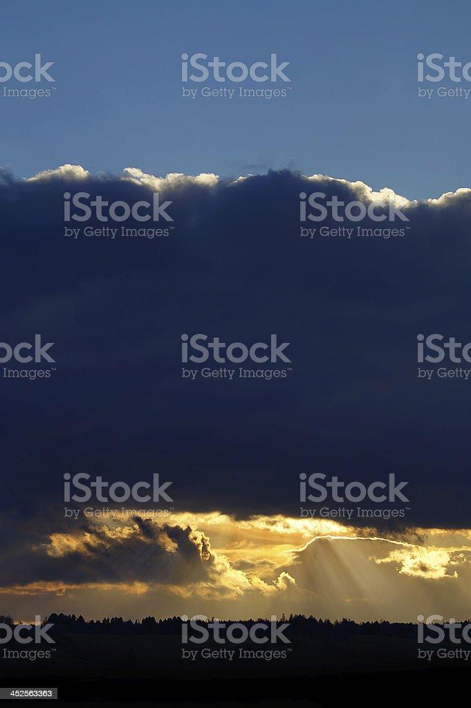 Paradise: Rays of light shining through dark clouds royalty-free stock photo