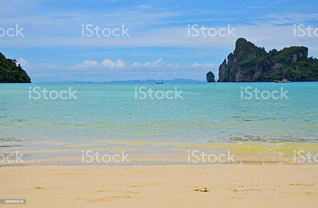 Paradise tropical sand sea beach with rock royalty-free stock photo