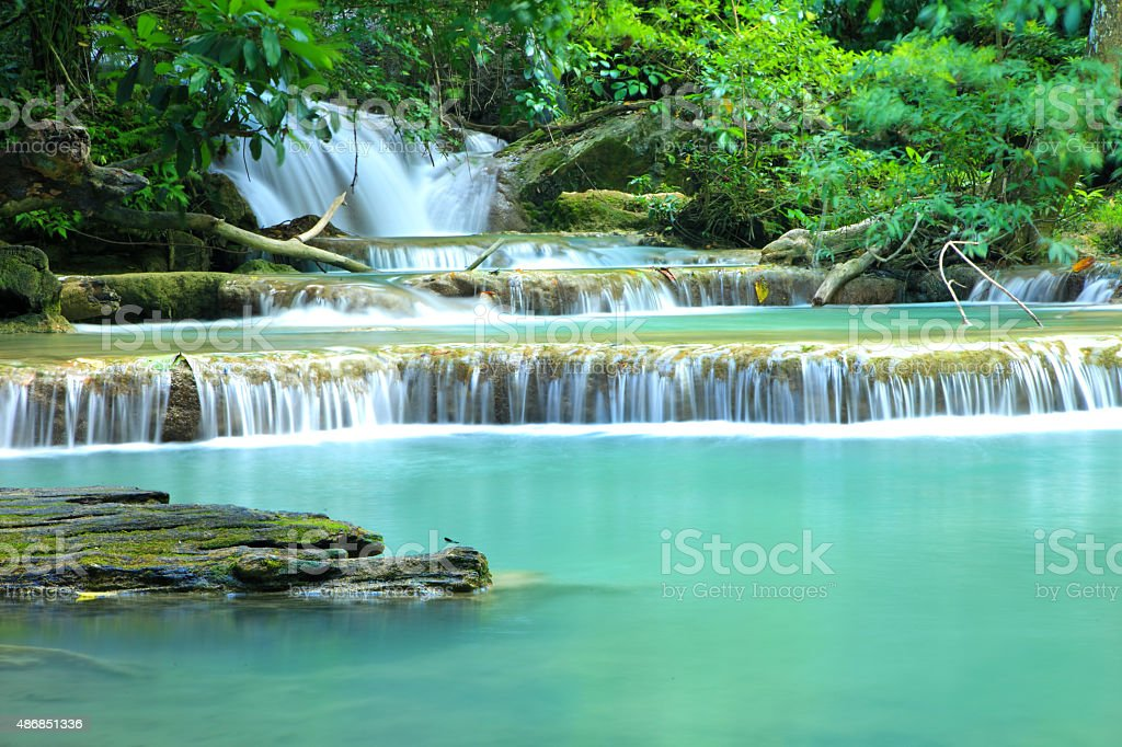 Paradise Waterfall located in deep forest of Thiland. stock photo