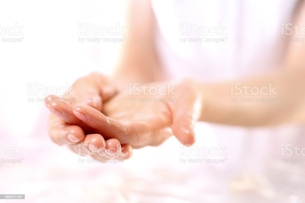 Paraffin hand treatment, beauty salon stock photo