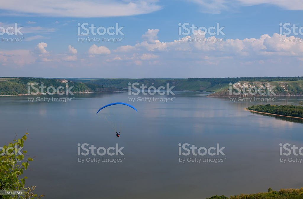 Paraglider above Bakota beautiful reservoir in the clouds stock photo