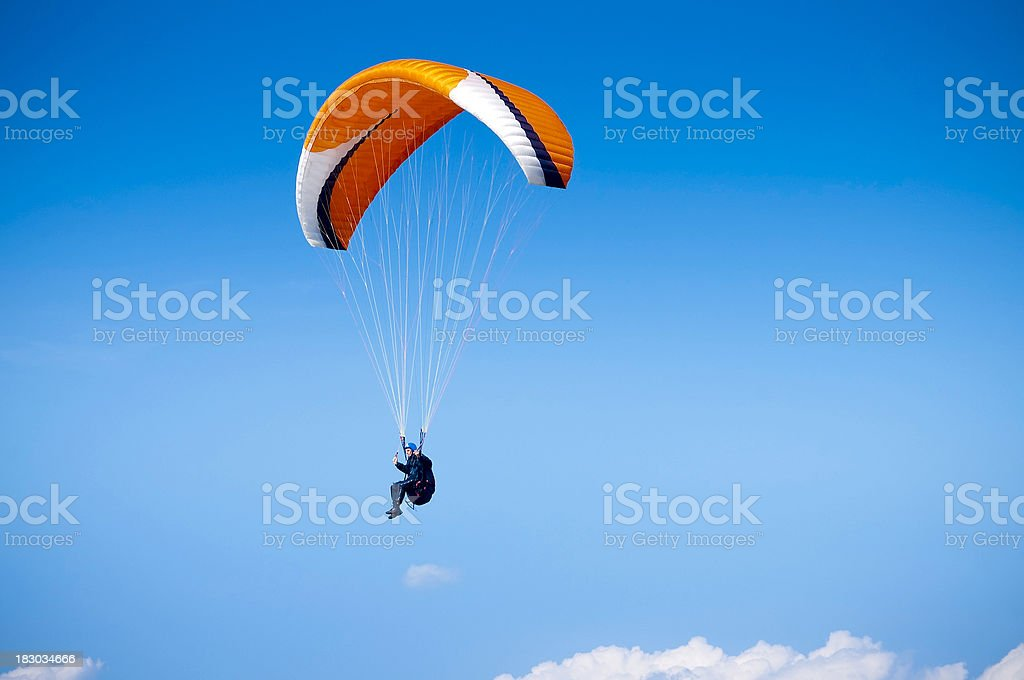 Paraglider, airborne against big blue sky, UK stock photo