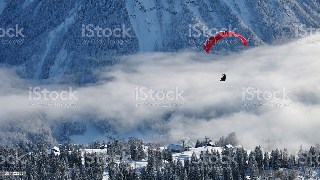 Paraglider and winter landscape stock photo