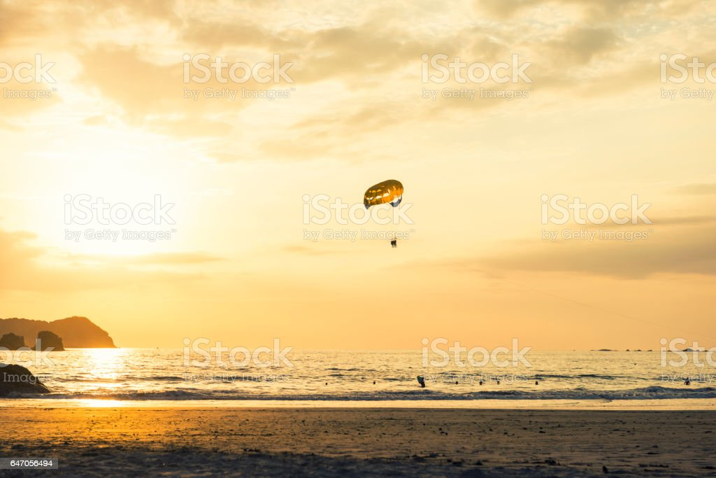 Paraglider at Sunset on the beach stock photo