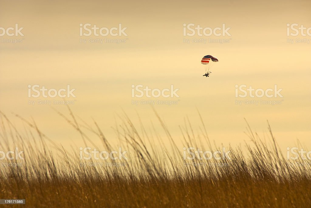 Paraglider Demonstrates Freedom in the Sky During Dramatic Sunset royalty-free stock photo