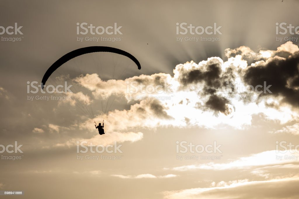 Paraglider enjoying evening sun stock photo