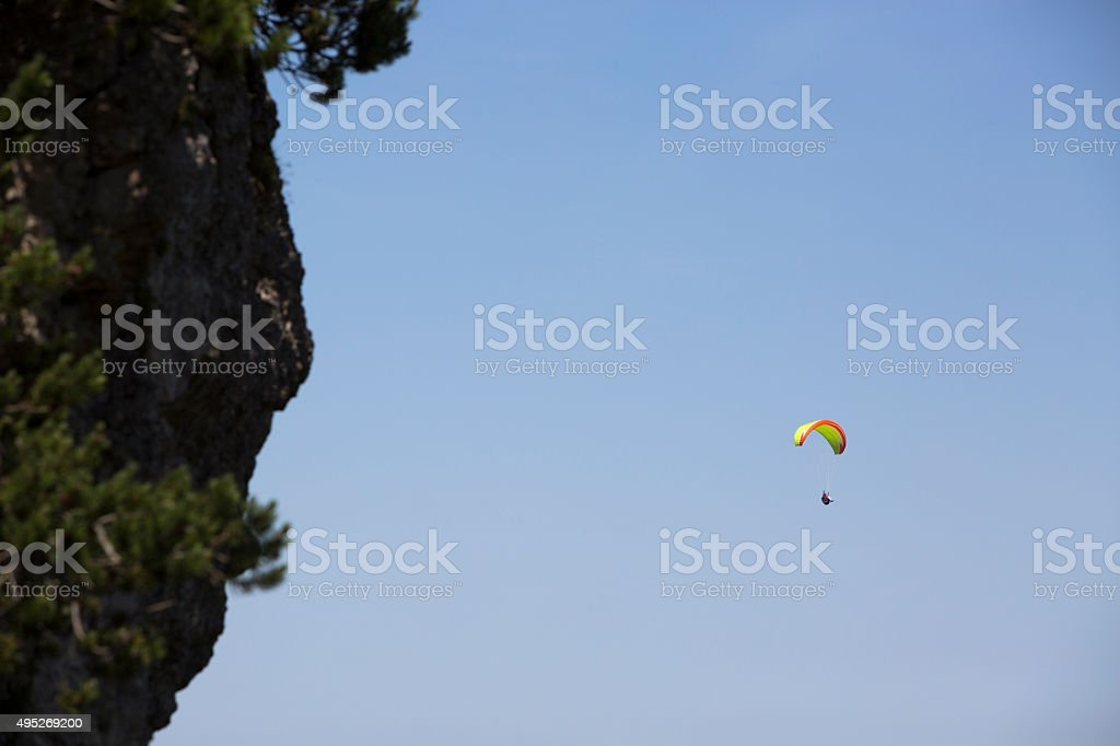 Paraglider flying over Bavarian mountains stock photo