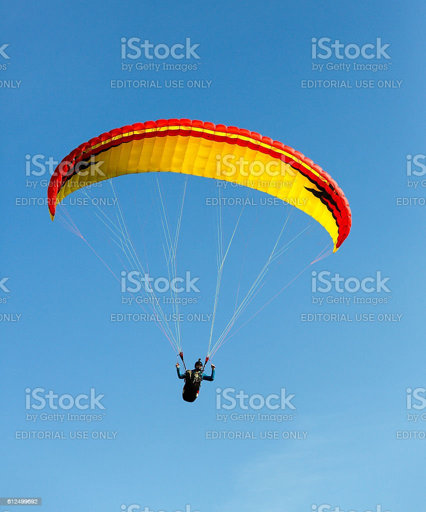 Paraglider flying over Mount Ulriken in summer day. stock photo
