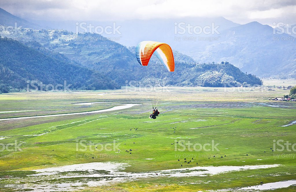 Paraglider flying over the beautiful Pokhara valey stock photo