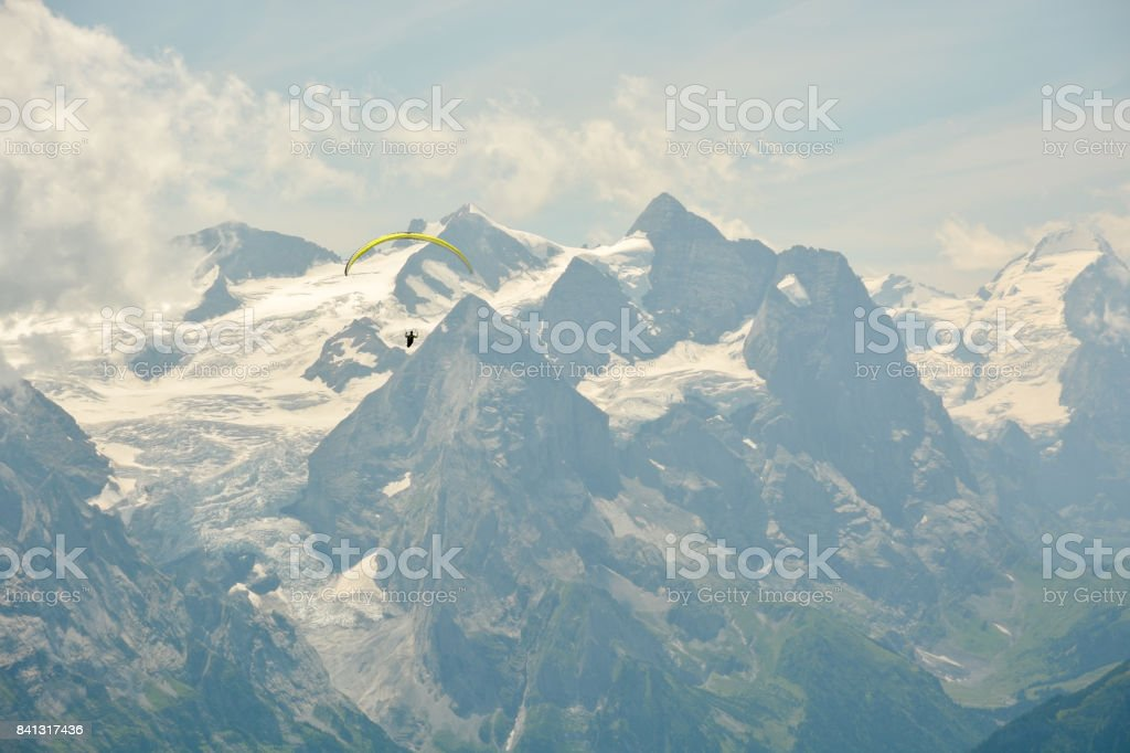 Paraglider in beautiful Swiss Alps stock photo