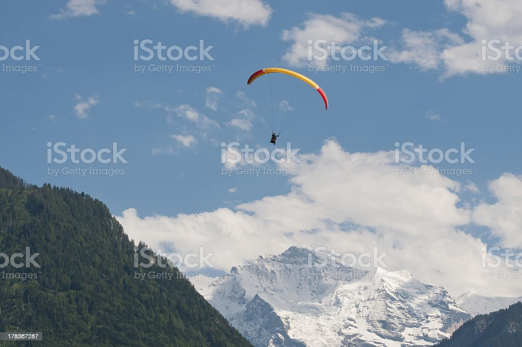 Paraglider in front of Swiss Alps royalty-free stock photo