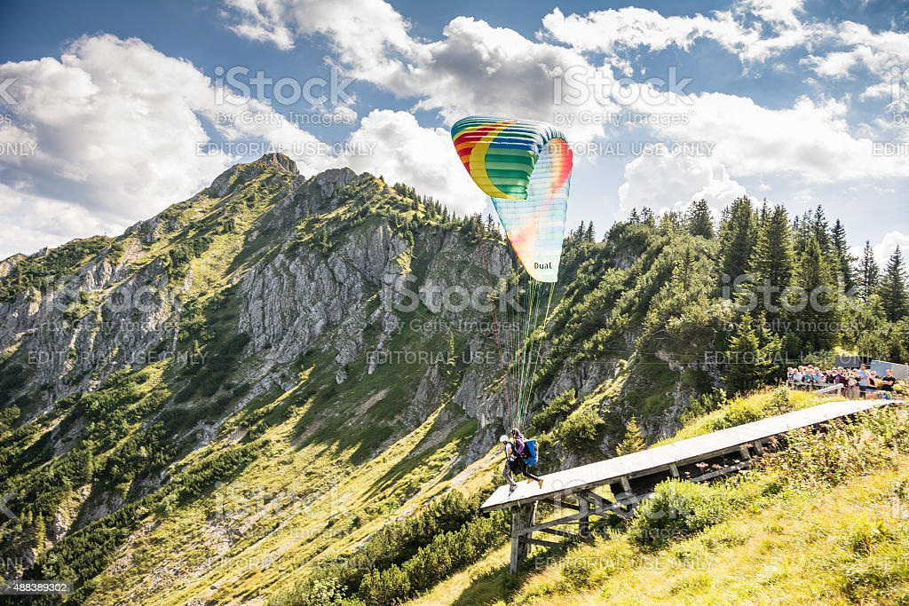 Paraglider in the alps stock photo